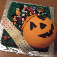 Trick Or Treat Cake!  A gum paste jack o lantern candy bag (not edible. It was a covered-foam ball) with sculpted fondant-candy pieces; from old fashioned candy...