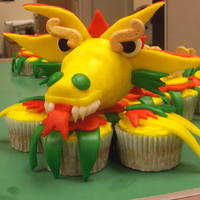 Chinese New Year- Dragon Cupcakes I was given a calendar of cupcakes for Christmas and told I should do each picture for practice... well, here's one! His head is an...