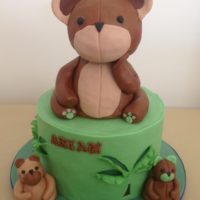 Teddy Cake. An eight inch round, covered in modelling chocolate to create the cut out effect for the palm trees. Teddy is made from RKT, then covered...