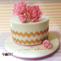 Gold Chevron Cake. Chocolate orange mud cake, ganached, with handmade peonies.