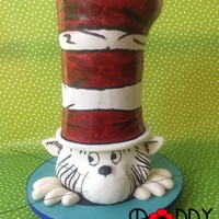 Cat In The Hat! This cake was quite a challenge! His entire hat is made of cake (three tiers!) The head is a dummy, with modelling chocolate used to mould...