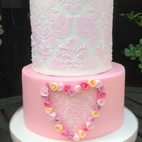 Pink And White Feminine Birthday Cake. Bottom tier is a dummy covered in MFF. Top tier is cookies & cream, filled with French Vanilla meringue buttercream, ganached and...