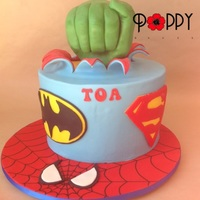 Superhero Themed Cake. I made the fist from Rice Crispy Treats, using my own fist as a reference. I think this means I have hulk hands?