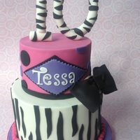 Zebra Stripe Birthday Cake. Bottom tier is chocolate mud cake, ganached and covered in home made MFF. The top tier is a dummy. The topper is home made gumpaste. I...