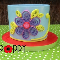 Blue Flower Cake. The cake is red velvet, covered in ganache and MFF. I have never tried quilling before, with paper or gumpaste. I learnt a lot, and made...