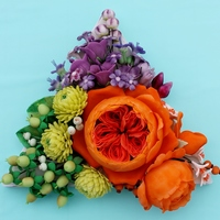 Triadic Colors Of Green Purple And Orange Sugar Flowers Triadic colors of green, purple, and orange sugar flowers.