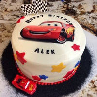 Lightening Mcqueen Cake   edible topper and black sanding sugar for track at base
