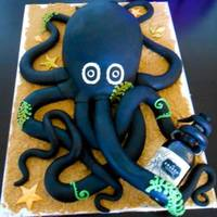 Kraken Octopus Cake Holding His Bottle Of Rum This Cake Is Five Delicious Layers Of Chocolate Cake And Whipped Fudge Filling He Was A Chal... Kraken Octopus cake holding his bottle of rum! This cake is five delicious layers of chocolate cake and whipped fudge filling. He was a...