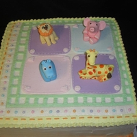 Animal Print Napkin Baby Shower Cake This was a replica of a napkin that I was given to create a cake for the baby shower. Animals & squares in fondant; cake covered and...
