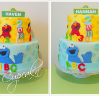A Sesame Street Themed Birthday Cake With Fondant Cut Outs Displayed Are The Two Opposite Sides Of The Cake Celebrating The Birthday Of Twi... A Sesame Street themed birthday cake with fondant cut outs. Displayed are the two opposite sides of the cake celebrating the birthday of...