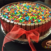 Kitkat And M&ms Cake Kitkat and M&Ms chocoloate cake with nutella cream frosting.