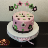 "Star Flower Girl Cake 6"" pink fondant cake decorated with cute green, white and brown star flowers."