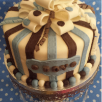 Blue & Brown Baby Boy Shower Cake 8 inch baby boy cake decorated with blue and brown stripes and topped with multi loop bow and spiral fondant.