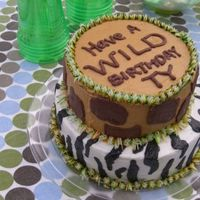 Wild Animal Cake Giraffe and Zebra combo with 'safari grass'. chocolate and vanilla BC on a chocolate and vanilla cake filled with vanilla pudding...
