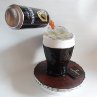 Guinness Floating Beer Can Cake Made for my dad. not happy with how it turned out, everything went wrong from start to finish, oh well, he liked it