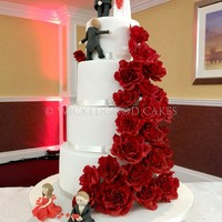 Wedding Cake With Handmade Sugar Roses Figures Were Supplied By Bride And Groom Wedding cake with handmade sugar roses. Figures were supplied by bride and groom