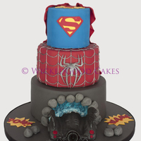 Superhero Cakes 3 tier superhero cake for a 4 year old. I tried to make it a little different to the usual ones by adding the Batmobile :)