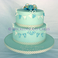 Elephant Christening Cake A christening cake based on a similar design that the customer had seen, with the addition of the elephant made to look like her son's...