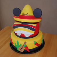 First Birthday / Cinco De Mayo / Mickey Mouse Cake This cake was for a boy's first birthday. His birthday is in early May and his party fell on Cinco De Mayo. His parents are huge...