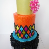 Mexican Art This cake was inspired by Mexican art. The top tier is wrapped in wafer paper with a wafer paper flower, the middle and bottom tiers are...