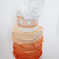 Orange Ombre Cake Orange ombre fondant strips with wafer paper flower