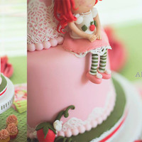 Strawberry Shortcake  A super sweet SSC cake made for a special birthday girl. The SSC is all fondant as are the strawberry and flower detailing. I loved using...