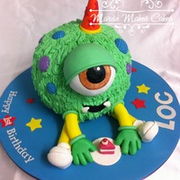 Weird Little Monster Dude Cake chocolate cake with butter cream frosting 'hair' and marshmallow fondant accents.