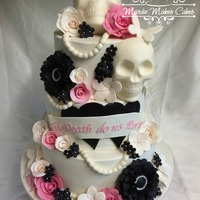 Skulls Wedding Cake a unique wedding cake for a unique couple. all chocolate cakes with smbc filling and mmf everything else. thanks for looking :)