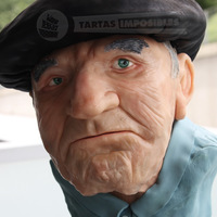 The Grandpa's Whim Brownie and orange buttercream. Grandpa is made with modelling chocolate and beret with RKT.