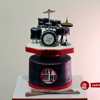 Hey Ho Lest's Go! A drum set cake with RAMONES logo and their famous phrase hit for a friend's 40th birthday. All done with fondant and gum paste. It...