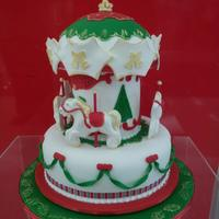 Christmas Carousel Christmas cake I did for a raffle . It is made from rich fruitcake.