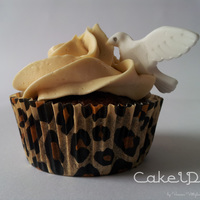 Peanut Butter Cupcake With Dove Chocolate Cupcakes with Peanut Butter frosting and little doves to decorate. :)