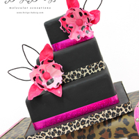 """leo"" Square Animal Print Wedding Cake with pink sugarflowers and foliage in ""leopard"" pattern."
