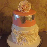 Rosette Ruffle Cake Pink and silver cake with fondant rosette ruffles and silver leaf
