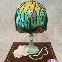Dragonfly Tiffany Lamp Tiffany Dragonfly Lamp, with isomalt hand-painted dragonflies. Painted fondant over a gluten free white chocolate mud cake.