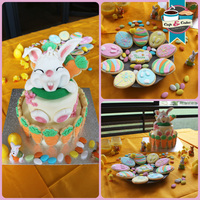 Easter Table Bunny Sculpted In Modelling Chocolate Decorated With Sugar Paste And Little Carrot Cookies Decorated With Royal Icing Egg Easter table. Bunny sculpted in modelling chocolate, decorated with sugar paste, and little carrot cookies, decorated with royal icing. Egg...
