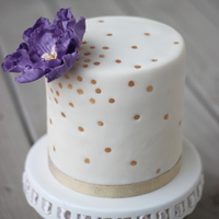 Gold Dots With Purple Gumpaste Flower Gold dots with purple gumpaste flower