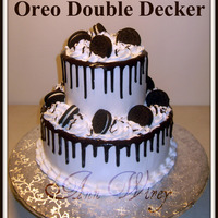 Oreo Double Decker White Almond Cake with Oreo Buttercream Filling. Topped with Dark Chocolate Ganache and Double Stuffed Oreo's.