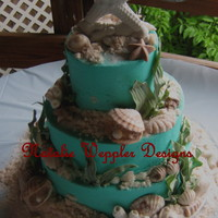 This Is A Buttercream Cake That Is Decorated With Gumpaste And Chocolate Molded Shells And Coral The Sea Weed Is Gumpaste As Well And The  This is a buttercream cake that is decorated with gumpaste and chocolate molded shells and coral. The sea weed is gumpaste as well and the...
