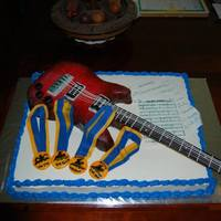 This Is A Graduation Cake Done For A Guy Who Loved To Play Guitar Jazz Music And Was A Swimmer In School   *this is a graduation cake done for a guy who loved to play guitar, jazz music, and was a swimmer in school.