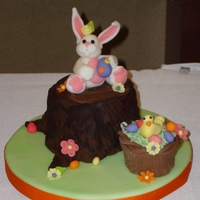 Easter Bunny Easter Bunny on stump with Easter basket and chick. Bunny, chick, flowers and eggs are all fondant. Basket is bottom half of a cupcake