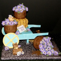Flower Baskets Flower baskets are cupcakes covered in wood-grain embossed fondant. Flowers are gumpaste & painted with food coloring. Haybale is rice...
