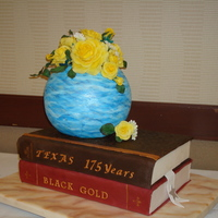 Stacked Book Cake With Vases And Yellow Roses Stacked books with round blue vase and yellow roses. Artistic impression entry for North Texas Cake and Sugar Art Show