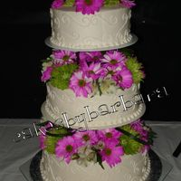 White Wedding With Pink/green Flowers done for a couples session through church that ended in a vow renewal ceremony and celeebration. 8/10/12 yellow cake with buttercream icing...