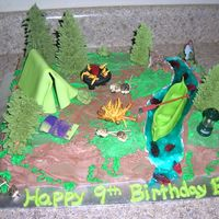 Camping Cake  Trees are Sugar Cones with Royal Icing, bushes and fire are Royal Icing. Water is piping gel with teal tint and swedish fish gummies.Tent,...