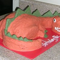 Dinosaur  my first attempt at a carved cake. Instructions came from the internet. Spikes are graham crackers covered in bc icing. Teeth are tic tacs...