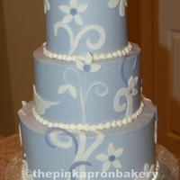 Blue Round Wedding Cake With Fondant Details Blue, round wedding cake, with fondant details.