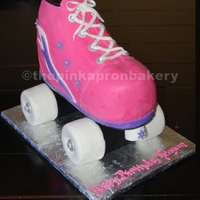 Carved Rollerskate Cake three dimensional roller skate cake covered in fondant. Wheels are rice krispy treats covered in fondant.