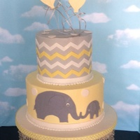 Yellow, Grey Baby Shower Cake. Buttercream cake with fondant chevron stripes. Love the yellow and grey color scheme. Balloons made out of gumpaste.