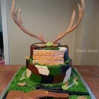 Deer Antler/hunting Cake This is a butter cream cake with fondant/gum paste antlers, gun, sign, and leaves.